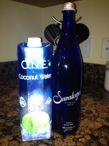Coconut water and spring water in a glass bottle are Dr. Michael Langes two favorite ways to rehydrate.
